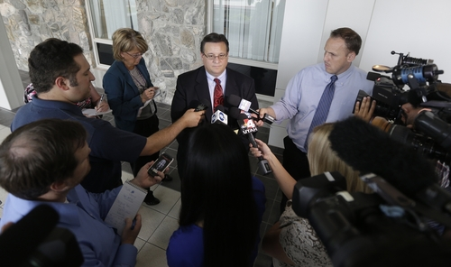 Todd Utzinger, attorney for a 15-year-old boy charged in the stabbing deaths of his younger adopted brothers, talks with reporters following his initial appearance Tuesday, July 16, 2013, in juvenile court, in Farmington, Utah.  The boys, ages 4 and 10, were found stabbed to death inside their West Point home on May 22 after they were left home alone with their older brother.   (AP Photo/Rick Bowmer, Pool)