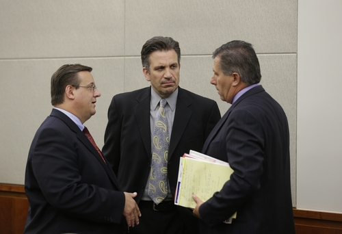 From left to right, Todd Utzinger, Brian Hart, and Todd Sessions, legal representatives for a 15-year-old boy charged in the stabbing deaths of his younger adopted brothers are shown following his initial appearance Tuesday, July 16, 2013, in juvenile court, in Farmington, Utah.   (AP Photo/Rick Bowmer, Pool)