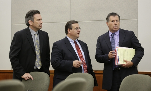 From left to right, Brian Hart, Todd Utzinger and Todd Sessions, legal representatives for a 15-year-old boy charged in the stabbing deaths of his younger adopted brothers are shown following his initial appearance Tuesday, July 16, 2013, in juvenile court, in Farmington, Utah.  The boys, ages 4 and 10, were found stabbed to death inside their West Point home on May 22, 2013, after they were left home alone with their older brother.  (AP Photo/Rick Bowmer, Pool)