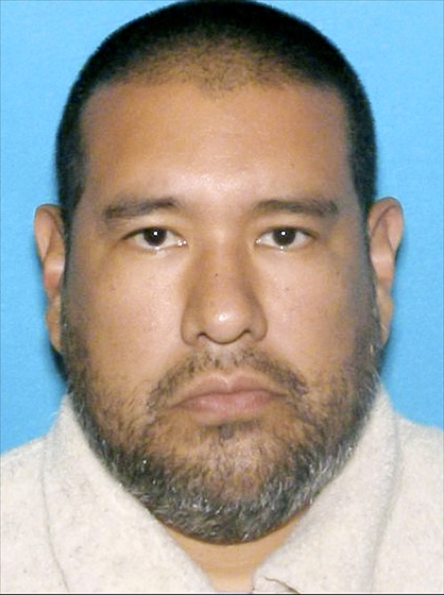 40-year-old Dr. Anthony Garcia is pictured in this photo released by the Omaha Police. Omaha Police Chief Todd Schmaderer said that Garcia was arrested Monday, July 15, 2013, in Illinois. Garcia has been linked to both the May 2013 Omaha slayings of 65-year-old Roger Brumback and 65-year-old Mary Brumback and the 2008 stabbing deaths of an 11-year-old Thomas Hunter and his family housekeeper, 57-year-old Shirlee Sherman. The slain Brumback and Hunter fired Garcia in 2001 when he was a pathology resident at Creighton Medical School. (AP Photo/Omaha Police Department)