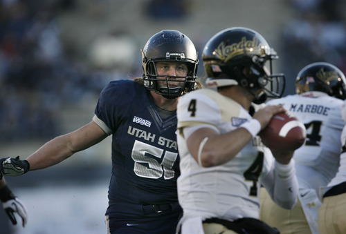 Scott Sommerdorf  |  The Salt Lake Tribune               Utah State Aggies linebacker Jake Doughty (51) rushes in untouched on Idaho Vandals quarterback Logan Bushnell (4) during second half play. Utah State defeated Idaho 45-9 in Logan, Saturday, November 24, 2012 to become champions of the WAC.