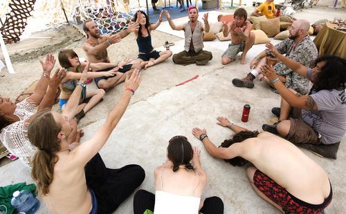 "Rick Egan  | The Salt Lake Tribune   Chromatest (center, back)  leads the "" Monkey Chant"" at center camp during the Element 11 Arts Festival at Bonneville Seabase, July 12, 2013."