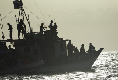 A statue of the Virgin of Carmen, forth from right, is carried in a boat during a religious procession in the Pacific Ocean off San Juan del Sur, Nicaragua, Tuesday, July 16, 2013. Nicaragua's fishing community celebrate the feast day of the Virgin Carmen who is worshipped by Catholics as the patron saint of fishermen and sailors. (AP Photo/Esteban Felix)