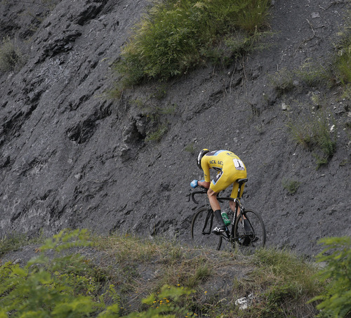 Stage winner Christopher Froome of Britain, wearing the overall leader's yellow jersey, rides during the seventeenth stage of the Tour de France cycling race an individual time trial over 32 kilometers (20 miles) with start in Embrun and finish in Chorges, France, Wednesday July 17, 2013. (AP Photo/Christophe Ena)