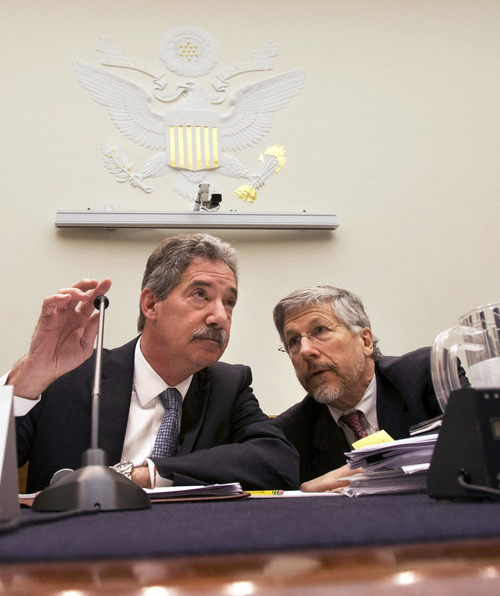 Deputy Attorney General James Cole, left, covers the microphone as he speaks with Robert S. Litt, general counsel in the Office of Director of National Intelligence before the start of a House Judiciary Committee hearing. Seated at right is NSA Deputy Director John C. Inglis. Six weeks after a leaked document exposed the scope of the government's monitoring of Americans' phone records, the House Judiciary Committee calls on key administration figures from the intelligence world to answer questions about the sweeping government surveillance of Americans in war on terrorism, on Capitol Hill in Washington, Tuesday, July 16, 2013 in Washington, on Wednesday, July 17, 2013. (AP Photo/Jacquelyn Martin)