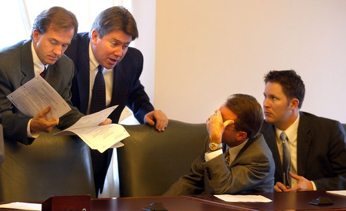 Republican legislators huddle in their caucus meeting this morning discussing budget matters. From left to right Rep. Chad Bennion,  Rep Greg Curtis, Rep Jeff Alexander, and  Rep. Morgan Philpot. photo: fraughton 12/18/02