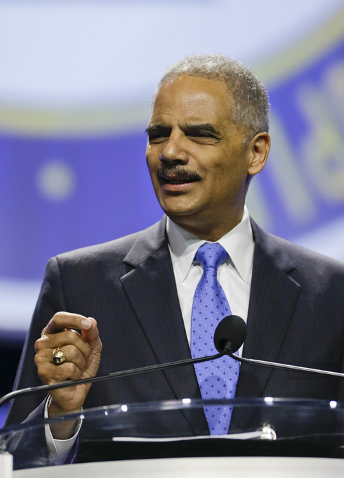 Attorney General Eric Holder delivers the keynote address at the annual NAACP convention, Tuesday, July 16, 2013, in Orlando, Fla. (AP Photo/John Raoux)