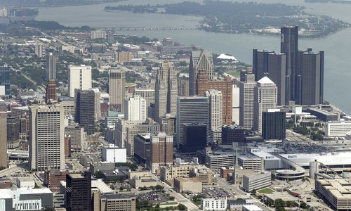 In this July 17, 2013, aerial photo is the city of Detroit. On Thursday, July 18, 2013, Detroit became the largest city in U.S. history to file for bankruptcy when State-appointed emergency manager Kevyn Orr asked a federal judge for municipal bankruptcy protection. (AP Photo/Paul Sancya)
