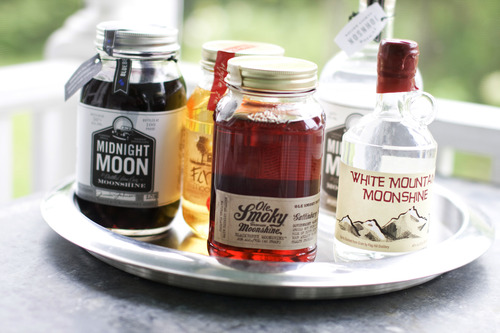 Matthew Mead  |  The Associated Press From left, Midnight Moon Blueberry, FireFly Moonshine Apple Pie Flavor, Ole Smoky Tennessee Moonshine Blackberry, Midnight Moon Moonshine, and White Mountain Moonshine are shown in Concord, N.H.