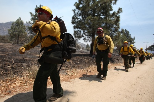 Members of the Mountaineer Fire Crews from Northern California start their hike near Pine Springs Ranch in Mountain Center, Calif. to fight the Mountain Fire Thursday, July 18, 2013. (AP Photo/The Desert Sun, Richard Lui)  RIVERSIDE PRESS-ENTERPRISE OUT;  NO SALES; NO FOREIGN
