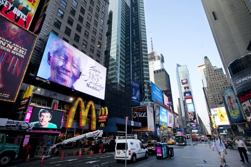 An electronic billboard announces Nelson Mandela's 95th birthday in New York's Times Square, Thursday, July 18, 2013. South Africa celebrated Nelson Mandela's 95th birthday on Thursday, a milestone capped by news that the former president's health was improving after fears that he was close to death during ongoing hospital treatment. (AP Photo/Mark Lennihan)