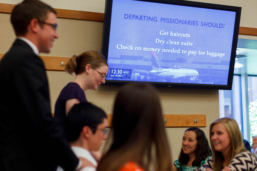 Trent Nelson  |  The Salt Lake Tribune A video screen offers advice to departing missionaries at the LDS Missionary Training Center in Provo.