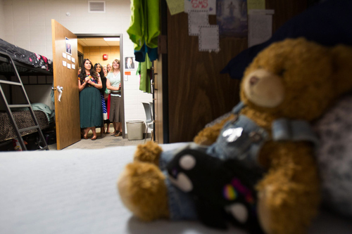 Trent Nelson  |  The Salt Lake Tribune Missionaries gather in the doorway to the dorm room they share at the LDS Missionary Training Center in Provo Tuesday June 18, 2013.