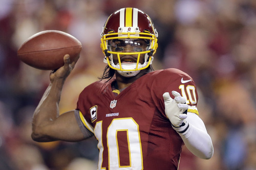 Washington Redskins quarterback Robert Griffin III passes the ball during the second half of an NFL wild card playoff football game against the Seattle Seahawks in Landover, Md., Sunday, Jan. 6, 2013. (AP Photo/Matt Slocum)