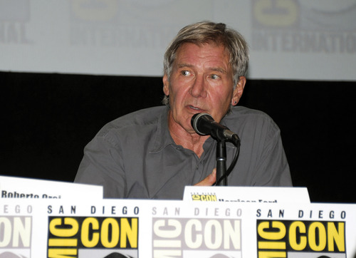 """Actor Harrison Ford answers a question at the """"Ender's Game"""" panel on Day 2 of the 2013 Comic-Con International Convention on Thursday, July 18, 2013 in San Diego. (Photo by Denis Poroy/Invision/AP)"""