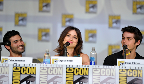 """IMAGE DISTRIBUTED FOR MTV - From left, Tyler Hoechlin, Crystal Reed and Dylan O'Brien participate in the """"Teen Wolf"""" panel at the San Diego Convention Center on Day 2 of Comic-Con International on Thursday, July 18, 2013, in San Diego, Calif. (Photo by John Shearer/Invision for MTV/AP)"""