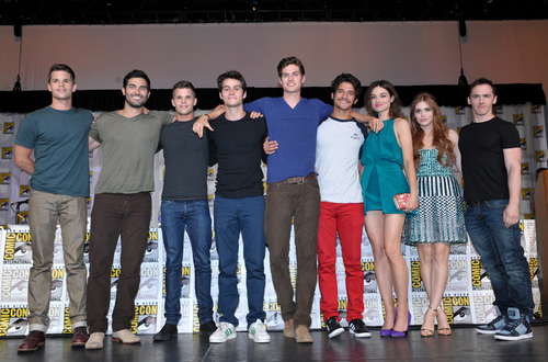 """IMAGE DISTRIBUTED FOR MTV - From left, actors Max Carver, Tyler Hoechlin, Charlie Carver, Dylan O'Brien, Daniel Sharman, Tyler Posey, Crystal Reed, Holland Roden and writer Jeff Davis attend the """"Teen Wolf"""" panel at the San Diego Convention Center on Day 2 of Comic-Con International on Thursday, July 18, 2013, in San Diego, Calif. (Photo by John Shearer/Invision for MTV/AP)"""