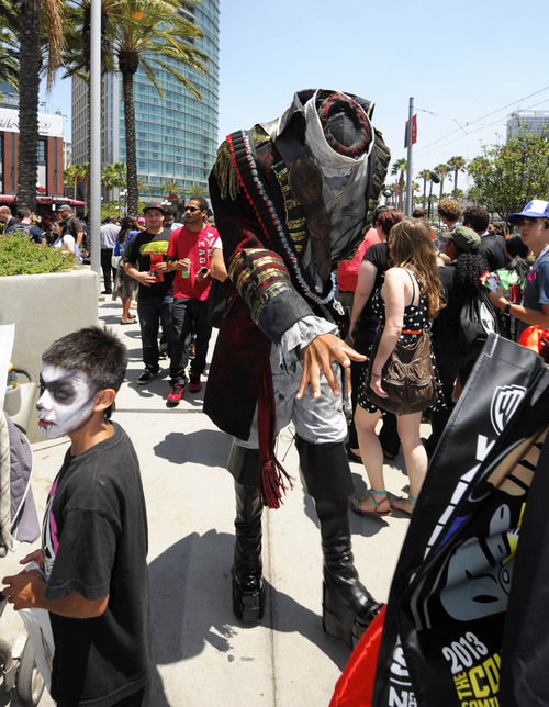 A headless sailor walks in the crowds outside of the San Diego Convention center on Day 2 of the 2013 Comic-Con International Convention on Thursday, July 18, 2013, in San Diego. (Photo by Denis Poroy/Invision/AP)