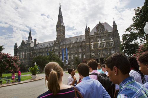 FILE - In this July 10, 2013 file photo, prospective students tour Georgetown University's campus in Washington. The Senate could vote as early as Thursday on a bipartisan compromise that heads off a costly increase for returning students.  (AP Photo/Jacquelyn Martin)