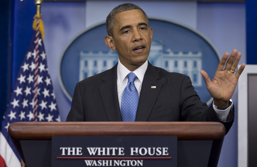 Carolyn Kaster  |  The Associated Press President Barack Obama gestures as he speaks during the daily news briefing at the White House, Friday, July 19, 2013, in Washington, about the fatal shooting of Trayvon Martin by George Zimmerman.