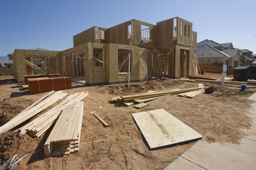 Rick Egan    The Salt Lake Tribune   Contractors work on a home on Granite Way, in the Cobblestone Subdivision in Washington, Utah, Friday, July 19, 2013.