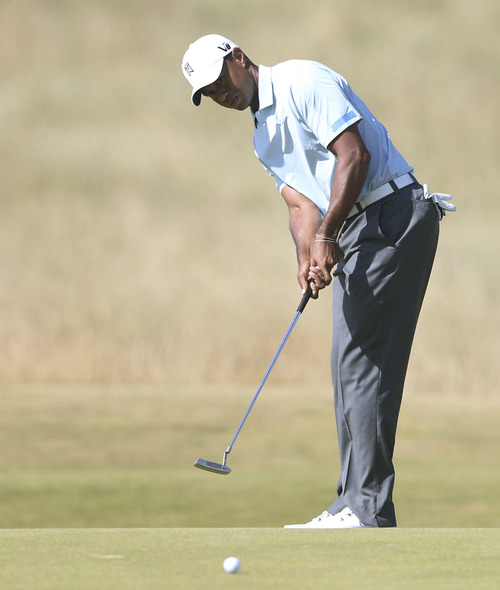Tiger Woods of the United States putts on the 4th green during the second round of the British Open Golf Championship at Muirfield, Scotland, Friday July 19, 2013. (AP Photo/Scott Heppell)