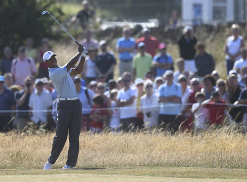 Tiger Woods of the United States plays a shot on the first fairway during the second round of the British Open Golf Championship at Muirfield, Scotland, Friday July 19, 2013. (AP Photo/Scott Heppell)