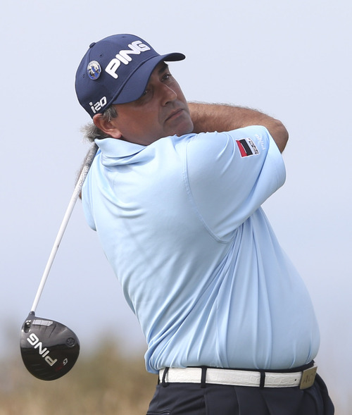 Angel Cabrera of Argentina plays a shot off the 6th tee during the first round of the British Open Golf Championship at Muirfield, Scotland, Thursday July 18, 2013. (AP Photo/Scott Heppell)