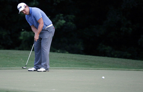Daniel Summerhays watches his putt on the seventh green during the second round of the Sanderson Farms Championship golf tournament on Friday, July 19, 2013, in Madison, Miss. Summerhays finished the hole with a birdie. (AP Photo/Rogelio V. Solis)