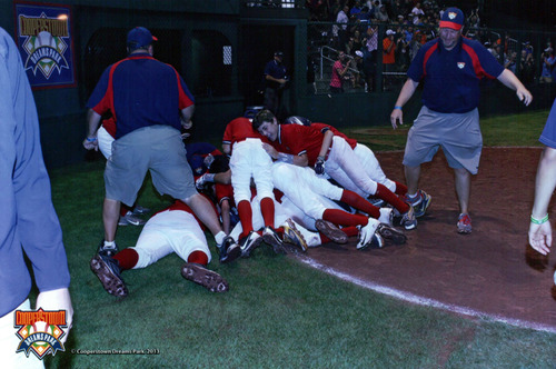 The Salt Lake Sidewinders baseball team piles on Ethan Fowlks in celebration after Fowlks' game-winning homer to clinch tournament title in Cooperstown, N.Y. Courtesy photo