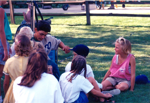 "PHOTO COURTESY OF JACKIE NIELSEN.  Character Benjamin Franklin ""The Jet"" Rodriguez's played by Mike Vitar surrounded by the Sugarhouse neighborhood kids on the set of the movie ""The Sandlot"" on Bryan Ave.  The Sandlot was filmed in 1993 is overgrown with weeds and since filming stopped, it has not been used for baseball. The Utah Film Commission has considered rebuilding the field and holding a 20-year reunion.  SLC 12/8/09"