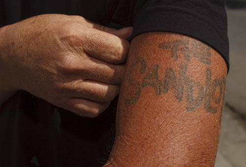 "Leah Hogsten  |  The Salt Lake Tribune The Sandlot movie screenwriter and director David M. Evans sports his sandlot tattoo on the replicated set of ""The Sandlot"" on the original site in the neighborhood of Glendale, Utah where the movie was filmed, along 1386 Glenrose Ave., Thursday, July 18, 2013."