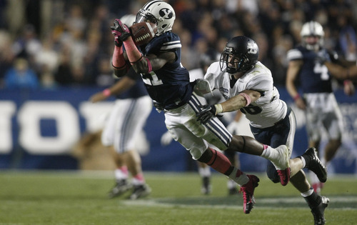 Chris Detrick  | Tribune file photo Brigham Young Cougars running back Jamaal Williams (21) can't make a catch under pressure from Utah State Aggies safety McKade Brady (36) during the second half of the game at LaVell Edwards Stadium Friday October 5, 2012.