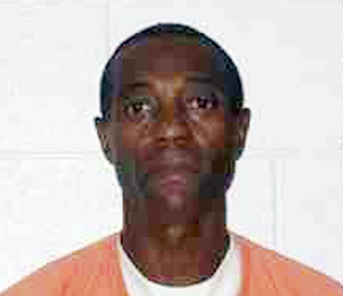 FILE - This 2007 file image provided by the Wyoming Department of Corrections shows Andrew Johnson. Prosecutors have dismissed charges against Johnson, a Cheyenne man who served 23 years in prison on a rape conviction before recent DNA testing prompted a judge to order him released. The testing showed that Johnson's DNA wasn't present in evidence taken from the victim in the 1989 rape case. Johnson is in his early 60s. (AP Photo/Wyoming Department of Corrections, file)