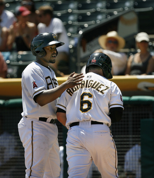 Scott Sommerdorf   |  The Salt Lake Tribune Luis Rodriguez is congratulated after hitting a 2-run HR to start the Bees comeback against the River Cats, Sunday, July 21, 2013. Down 5-1, the Bees came back to win 9-7.