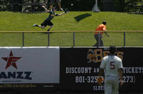 Scott Sommerdorf   |  The Salt Lake Tribune This fan in the outfield could not make the catch on The Bees' Luis Rodriguez' 2-run HR in the bottom of the fourth to start the Bees' comeback, Sunday, July 21, 2013. The Bees, down 5-1 in the fourth inning, came from behind to beat Sacramento 9-7.