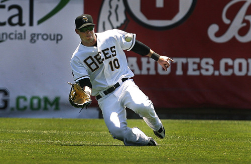 Scott Sommerdorf   |  The Salt Lake Tribune Bees RF TRent Oeltjen could not make the catch on this drive by the River Cats' Jemile Weeks that let in 2 runs and gave the River Cats a 5-1 lead in the top of the fourth inning, Sunday, July 21, 2013. The Bees came back to win 9-7.