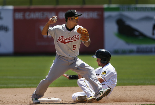 Scott Sommerdorf   |  The Salt Lake Tribune The Bees Cole Calhoun breaks up this double play by getting the River Cats' Hiroyuki Nakajima to hold the ball, Sunday, July 21, 2013. The Bees came back to beat Sacramento 9-7.