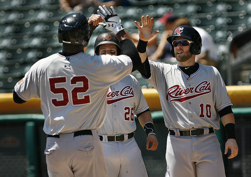 Scott Sommerdorf   |  The Salt Lake Tribune Sacramento River Cats players Stephen Vogt, #26, and Daric Barton, #10, greet Michael Taylor at home plate after they scored ahead of him on his 3-run home run in the first inning, Sunday, July 21, 2013. The River Cats led 3-0 after this blast, but lost 9-7 to the Bees.