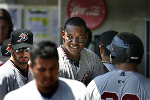 Scott Sommerdorf   |  The Salt Lake Tribune Sacramento River Cats player Michael Taylor looks back from the River Cats dugout after his 3-run first inning HR, Sunday, July 21, 2013. The River Cats led 3-0 after this blast, but lost 9-7 to the Bees.