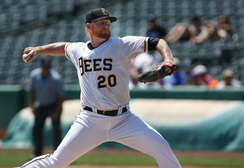 Scott Sommerdorf   |  The Salt Lake Tribune Bees starting pitcher Barry Enright delivers during second inning play against the Sacramento River Cats, Sunday, July 21, 2013. Enright gave up six hits and 5 earned runs over 6 innings in the Bees' 9-7 win over Sacramento.