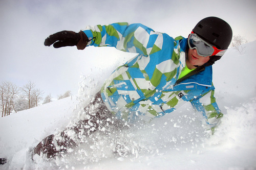 Powder Mountain - Braxton Tissot, 15, of upstate N.Y., carves the freshly fallen snow from an earlier storm as he skis the backcountry as part of the Snowcat Powder Safari program at Powder Mountain recently.  Photo by Francisco Kjolseth/The Salt Lake Tribune 02/10/2009