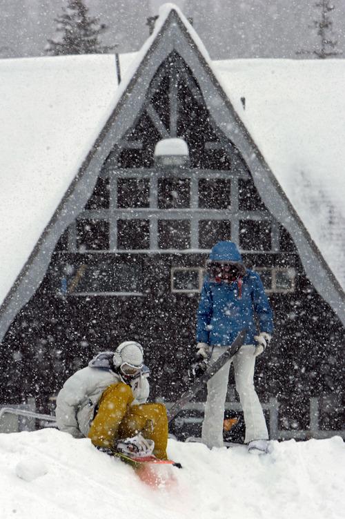 Francisco Kjolseth     The Salt Lake Tribune     Arthur Lacerda and his sister Vanessa take the sledding trip down to their car on their snowboardsin 2009 as the snow falls at the base of Brighton ski resort.