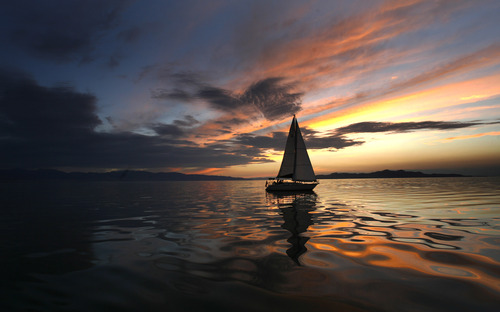 Rick Egan  |  The Salt Lake Tribune  Tim Loveday enjoys the last light of the day on the Great Salt Lake, in his Tartan 34,  Wednesday, August 22, 2012.