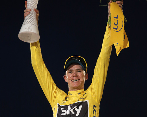 2013 Tour de France cycling race winner Christopher Froome of Britain, wearing the overall leader's yellow jersey, celebrates on the podium of the 100th edition of the Tour de France cycling in Paris, France, Sunday July 21 2013. (AP Photo/Christophe Ena)