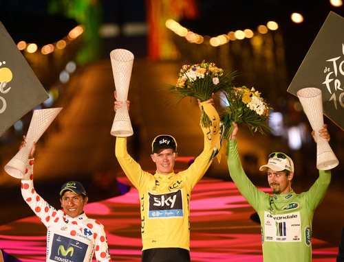 Christopher Froome of Britain, wearing the overall leader's yellow jersey, center, Nairo Alexander Quintana of Colombia, wearing the best climber's dotted jersey, left, and Peter Sagan of Slovakia, wearing the best sprinter's green jersey, react on the podium after the 21st and last stage of the 100th edition of the Tour de France cycling race over 133.5 kilometers (83.4 miles) with start in Versailles and finish in Paris, France, Sunday July 21 2013. (AP Photo/Bernard Papon, Pool)