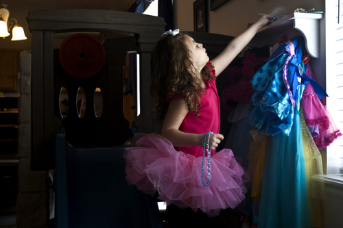 "Chris Detrick  |  The Salt Lake Tribune Lucy Vasquez, 4, likes dancing and playing ""dress up."" Her parents had high hopes in December, when their autistic daughter was picked in a lottery to receive free applied behavior analysis (ABA) therapy through a Medicaid pilot program."