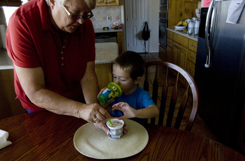 "Kim Raff  |  The Salt Lake Tribune Mary Kava prepares a snack for her grandson, Jason Jr., in their home in Castle Dale on June 21, 2013. Jason has autism and finding foods he likes is a chore, so Mary often sneaks pureed vegetables into ""JJ's"" pasta or pancakes."