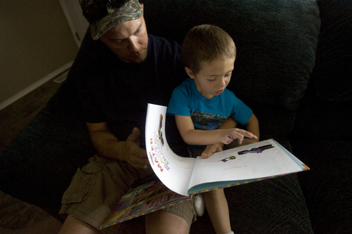 "Kim Raff  |  The Salt Lake Tribune Jason Kava reads to his son, Jason Jr., who has autism. Kava works full time at night and spends mornings working with ""JJ."" He sleeps when JJ naps."