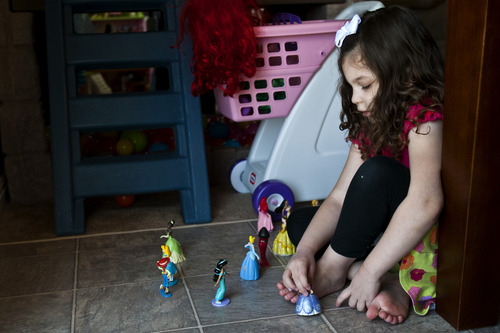 Chris Detrick  |  The Salt Lake Tribune Lucy Vasquez, 4, role plays with toys, parroting lines from movies. She has autism and knows dozens of words but rarely uses language to convey wants or feelings.